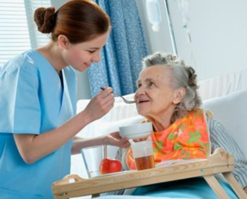 miracle-agency-elderly-lady-in-hospital-being-helped-with-feeding